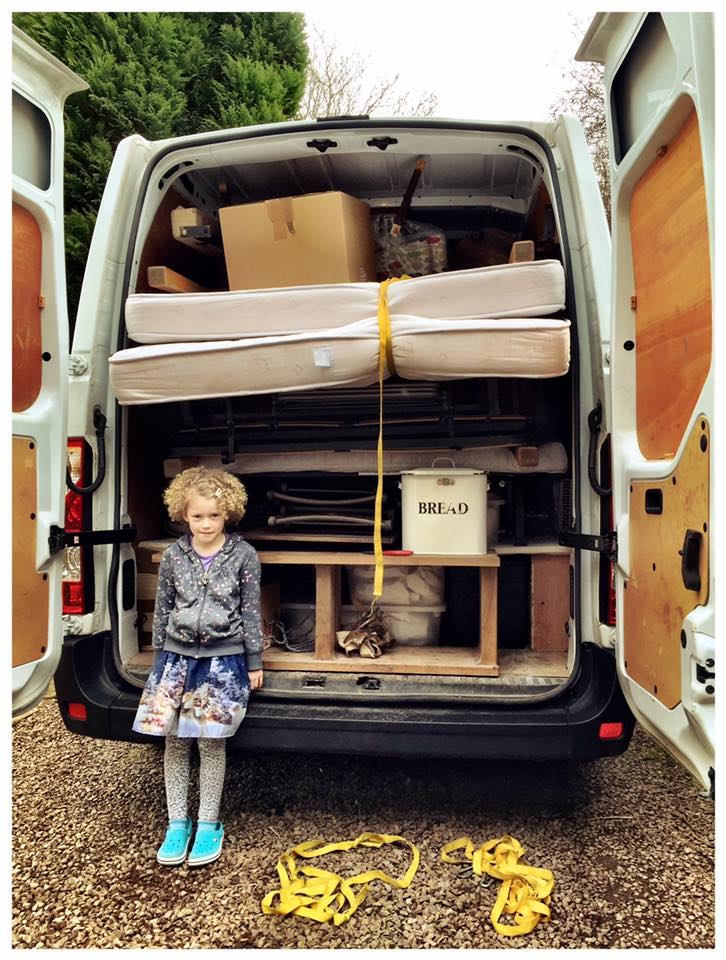 Molly Mae guarding the very full van